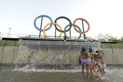 Children play in the water in the Olympic park Stock Photo