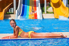 Children play in the water park. Stock Photos