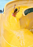 Children play on the water slide Stock Photography