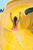 Children play on the water slide Royalty Free Stock Photo