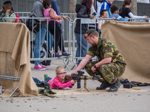 Children play with weapons on Army Day Royalty Free Stock Image