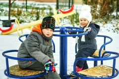 Funny brother and sister on winter walk royalty free stock photo