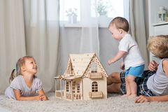 Children Play With A Doll House Royalty Free Stock Photography