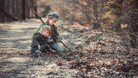 Children play in the woods Royalty Free Stock Photo