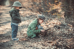 Children play in the woods. Small children play in the woods, photo in vintage style Stock Image