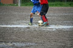 Children players during a football match in a playing field full Royalty Free Stock Photo