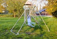 2 children playground 摇摆和滑的幻灯片 免版税库存照片