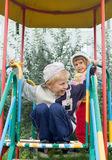 Children on a playground. The boy and the girl on a playground stock photo