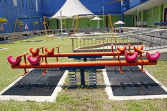 Children playground. An image of a children playground with a seesaw stock photos