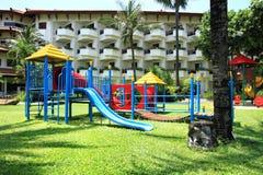 Children playground. A children playground with hotel background in Bali royalty free stock photo