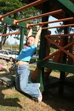 Children at the playground. Happy children playing at the playground in the park on sunny day Stock Photo