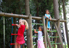 Children in playground. Three young girls playing in a playground. Diversity Royalty Free Stock Image