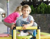 Children on playground in airport Stock Photo