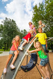 Children on playground construction play together stock photography