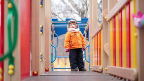Children on playground equipment Royalty Free Stock Image