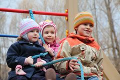 Children on playground hold on rope Stock Images
