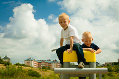 Children in playground kids boys playing on leisure equipment Royalty Free Stock Photo