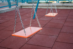 Children Playground 2. Little playground equipped with a metal swings for kids Stock Photography
