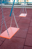 Children Playground. Little playground equipped with a metal swings for kids Stock Photo