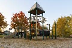 Children Playground in Neighborhood Park in Fall Season stock image