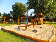 Children playground. New children playground with a sandpit, slides and climbers Stock Image