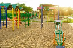 Children playground in a park. Modern colorful children playground in a park in rays of the sun royalty free stock image