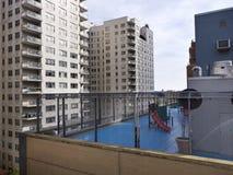 Children playground on rooftop in Manhattan New York. High rises all around Stock Photo