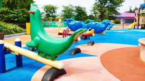 Children playground. Seesaw on outdoor children playground in park. Colorful play equipment on kids playground Stock Images