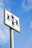 Children Playground sign. Playing kids in playground road sign on blue sky Stock Photos