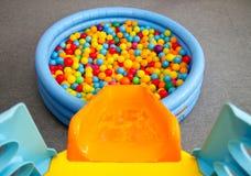 Children playground with slide. Empty children playground with slide and colourful balls Stock Photos