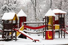 Children playground on snow blizzard Stock Photos