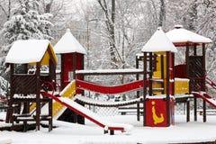 Children playground on snow blizzard Stock Photos