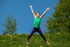 Children on the playground. Teenager girl jumping , Children on the playground royalty free stock images