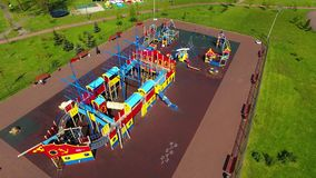 Children playground, view from above. Kaliningrad, Russia - May 11 2017: Some people are playing in the children playground on an embankment of Upper Lake in stock video