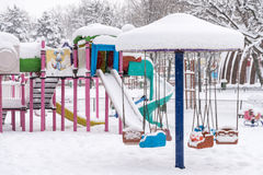 Children Playground In Winter Snow Stock Photos
