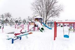 Children Playground In Winter Snow Stock Images