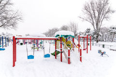 Children Playground In Winter Snow Royalty Free Stock Images