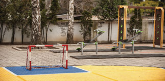 Children playground yard with soccer football goal, swings and s Royalty Free Stock Photography