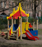 Children playground in the yard. In spring Royalty Free Stock Image