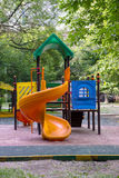 Children playground in the yard. In summer Royalty Free Stock Photos