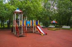 Children playground in the yard. In summer stock photos