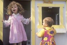 Children in a playhouse, Venice, CA Stock Photo