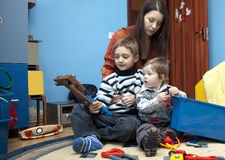 Children playing. Mother and children playing in their room Royalty Free Stock Images