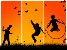 Children playing. Silhouettes of children playing sports Stock Photo