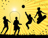 Children playing. Silhouettes of children playing sports Royalty Free Stock Image