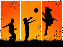 Children playing. Silhouettes of children playing sports Royalty Free Stock Photos