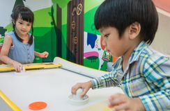 Children are playing with Air Hockey