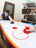 Children playing on air hockey Stock Images