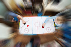 Children playing on air hockey Stock Image