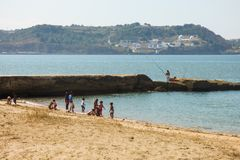 Children playing at Alges beach in Lisbon Royalty Free Stock Photography